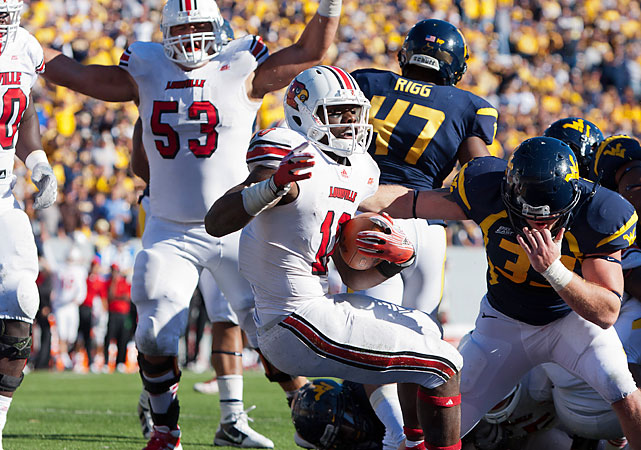 West Virginia beat Louisville to a Big 12 bid, but the Cardinals exacted some payback with a victory that shook up the Big East standings. The Cardinals (5-4, 3-1) were outgained 533-351 yards, but were boosted by returning a blocked field goal for a score. West Virginia (6-3, 2-2) got 410 yards from Geno Smith, but he couldn't bring them all the way back from a 10-point fourth-quarter deficit.