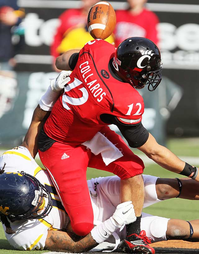 Cincinnati lost the game, but the Bearcats may have suffered a much greater loss: Quarterback Zach Collaros injured his knee while being tackled by Bruce Irvin (play pictured) and was carted off the field.