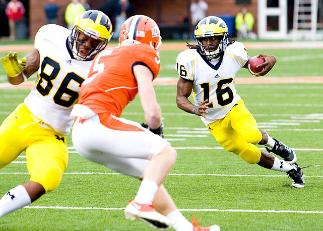Denard Robinson (pictured) got hit in the third quarter and did not return, but Michigan improved to 8-2 anyway thanks to another big day from running back Fitzgerald Toussaint, who rushed for 192 yards and a score. The Michigan defense held Illinois scoreless in the first half, and the Illini lost their fourth straight game as a result.