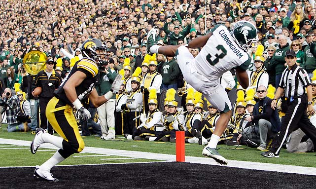 Iowa upset Michigan last week, but wasn't able to knock off Michigan State this week. Kirk Cousins found B.J. Cunningham (pictured) for two touchdowns, and the Spartans improved to 8-2 despite going just 4-of-16 on third-down conversions.