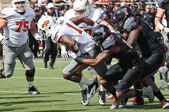 Texas Tech upset Oklahoma earlier this season. The Red Raiders didn't come close to repeating the feat against Oklahoma State. Joseph Randle (pictured) scored three rushing touchdowns to help the Cowboys improve to 10-0, while Brandon Weeden had another huge day through the air, passing for 423 yards and five scores.