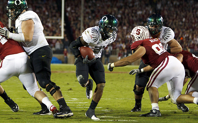 LaMichael James (center) ran for 146 yards and three touchdowns and Oregon (No. 7 BCS) sprinted past Stanford (No. 4 BCS), giving Andrew Luck's Heisman Trophy campaign a blemish and taking a giant step toward hosting the inaugural Pac-12 championship. James ran for scores from 1, 4 and 58 yards and had Stanford (9-1, 7-1) defenders slipping all over a slick field.