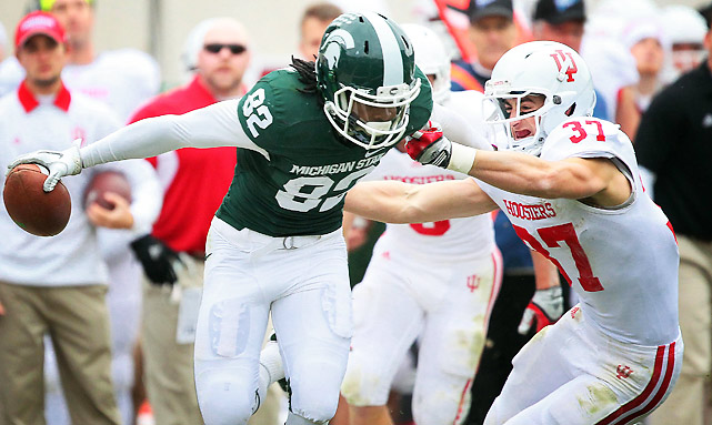 Michigan State took care of business against Indiana, and rival Michigan complied by beating Nebraska, securing the Spartans a spot in the first Big Ten championship game. Keshawn Martin (pictured) led the way with eight catches for 100 yards and a touchdown.