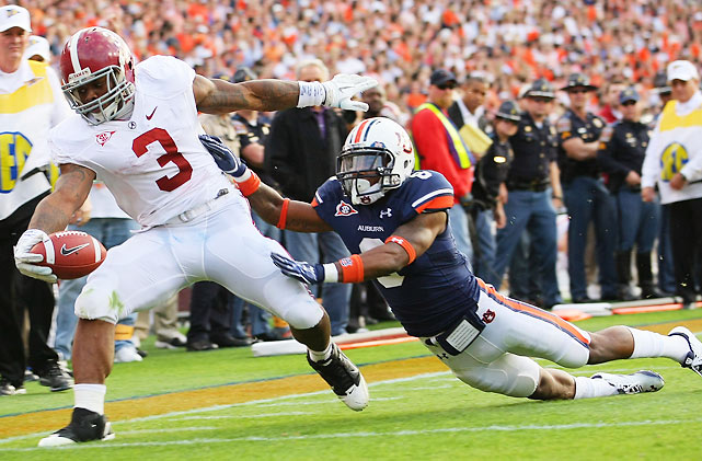 We've been spoiled by recent epic Iron Bowls, but this was an entirely one-sided affair. Auburn's two scores came on a defensive fumble return in the first half and a kickoff return to open the second half. Alabama, meanwhile, moved the ball at will thanks to a huge day from Heisman hopeful Trent Richardson (pictured), who rushed 27 times for 203 yards.