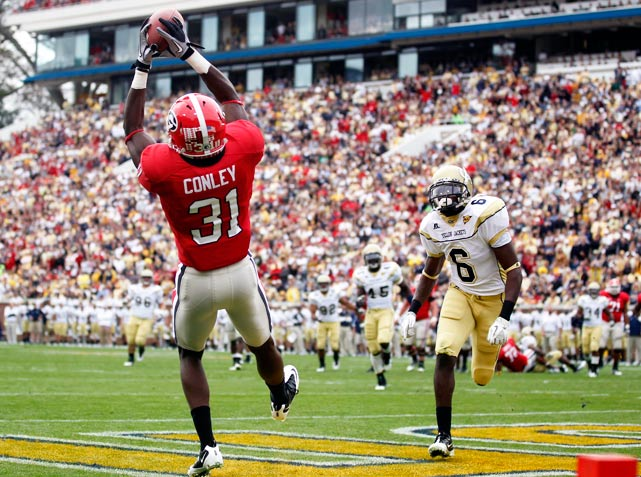 Georgia could have taken a week off after securing the SEC East crown last week, but rivalry weekend is no time for a hangover. Aaron Murray continued his torrid second-half, completing 19-of-29 passes for 251 yards and four touchdowns to four different receivers, including Chris Conley (pictured). Counterpart Tevin Washington didn't come close to matching that, passing for 34 yards and two interceptions while rushing 13 times for 42 yards.