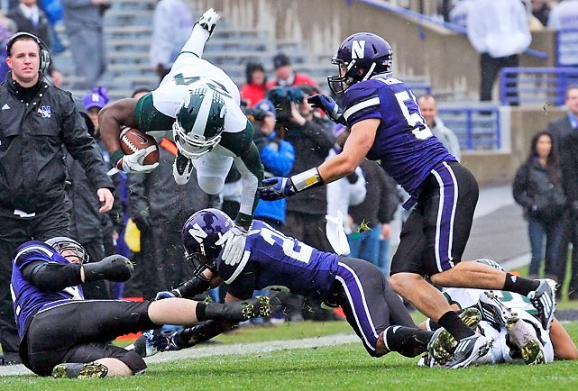 Despite locking up a spot in the Big Ten title game last week, Michigan State didn't get caught looking ahead. Le'Veon Bell (pictured) led the Spartans with 86 rushing yards and a rushing touchdown as MSU recorded double-digit regular-season wins for the second year in a row.