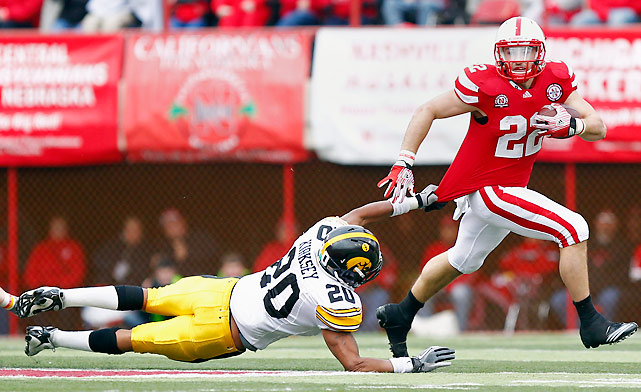 Rex Burkhead (pictured) started the week with his right foot in a walking boot; he ended it by rushing a school-record 38 times for 160 yards and a touchdown as Nebraska handled Iowa with ease in its regular-season finale. Nebraska has won nine games or more in each of Bo Pelini's first four seasons.