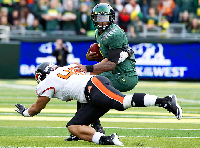 The Oregon Ducks have won the North. Quarterback Darron Thomas (pictured) had a big day through the air, completing 25-of-38 passes for 294 yards and four touchdowns, while the Ducks' defense forced Oregon State quarterback Sean Mannion into three turnovers (two picks, one fumble).