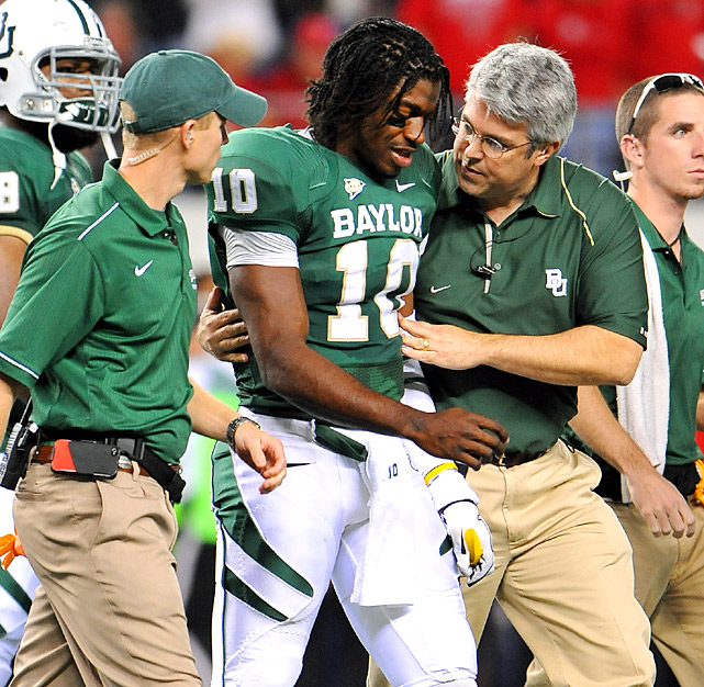 Nick Florence threw two long touchdown passes after Robert Griffin (center) was knocked out of the game and Baylor extended its winning streak to four. The Bears had to win it without Griffin, whose Heisman Trophy chances were dealt a setback because of an apparent concussion. BU coach Art Briles said he thought Griffin had a slight concussion but should be ready for the regular season finale next week at home against Texas.