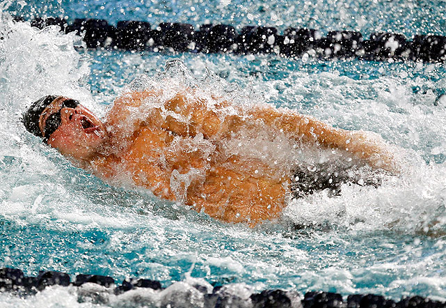 Ryan Lochte churns through the water during the 100m backstroke. Lochte took third in this event, and won the 200m individual medley, the 400m individual medley and the 200m backstroke.