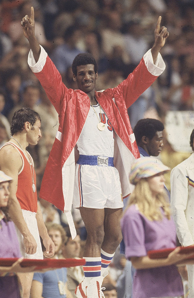 After winning Olympic gold alongside his older brother, Michael won titles at light heavyweight and heavyweight.