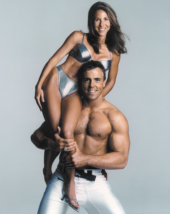 The former Broncos linebacker poses with his wife, Julie, during a photo shoot for the 2000 SI swimsuit issue.