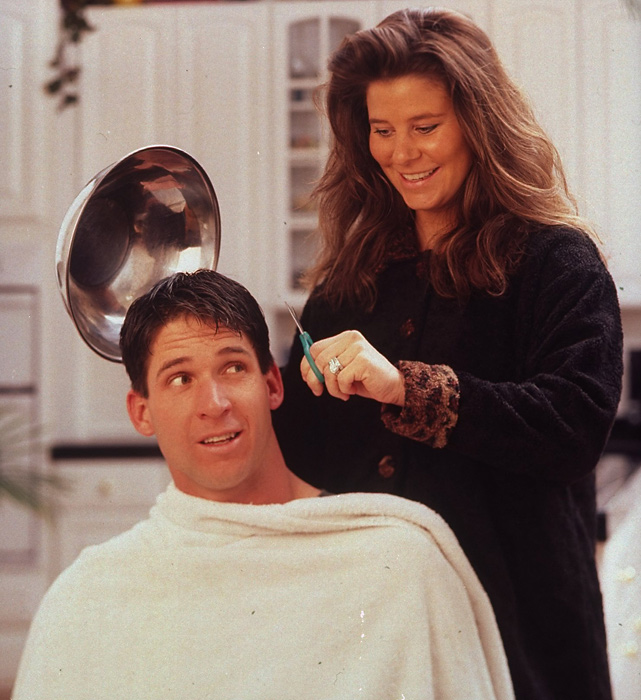 McCaffrey's wife, Lisa, threatens to give the former Broncos wide receiver a haircut in this 1998 photo. The couple have four children.