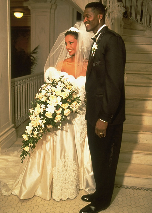 Dominique Wilkins poses with his bride, Nicole, on their wedding day in 1992. The couple were married for 11 years before divorcing in 2003.
