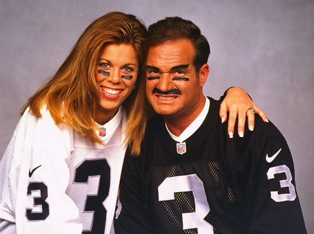 Teresa George dresses up like her husband, Oakland Raiders quarterback Jeff George, in a 1997 portrait. The couple has two children.