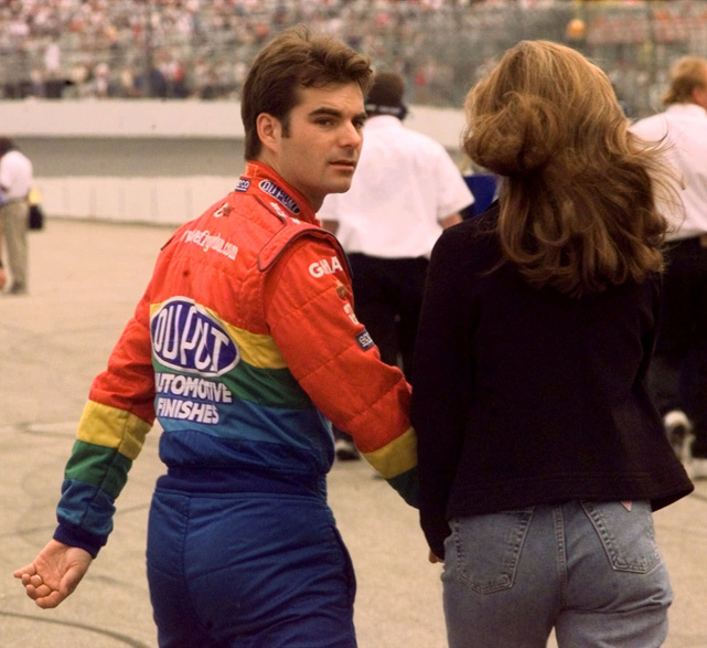 Gordon walks to his car with wife Brooke after winning the pole at the Jiffy Lube 300 in New Hampshire in 1999. Sealey was Gordon's first wife. The couple was married from 1994 to 2003. Gordon is currently married to model Ingrid Vandebosch.