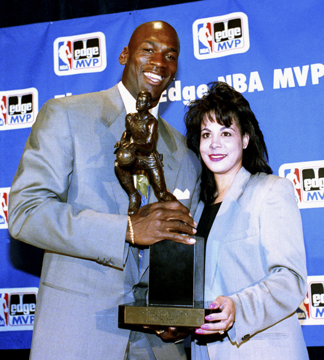 Jordan holds the 1991 NBA MVP award with his wife Juanita. The couple announced their divorce in 2006 after 17 years of marriage.