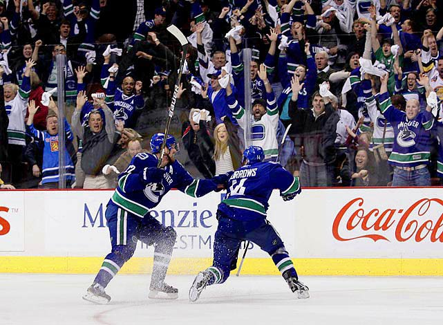 Nearly squandering a three-games-to-none lead, the Canucks finally vanquished their playoff nemesis with Alex Burrows' second goal of the game, off a turnover at 5:22 of overtime. After failing to cash in a third-period penalty shot, Burrows watched Chicago's Jonathan Toews score a short-handed goal with 1:56 left in regulation that sent the game into OT. Then, 24 seconds into the extra session, Burrows went to the penalty box for holding. He was spared the goat horns by goalie Roberto Luongo's sliding save on Patrick Sharp.