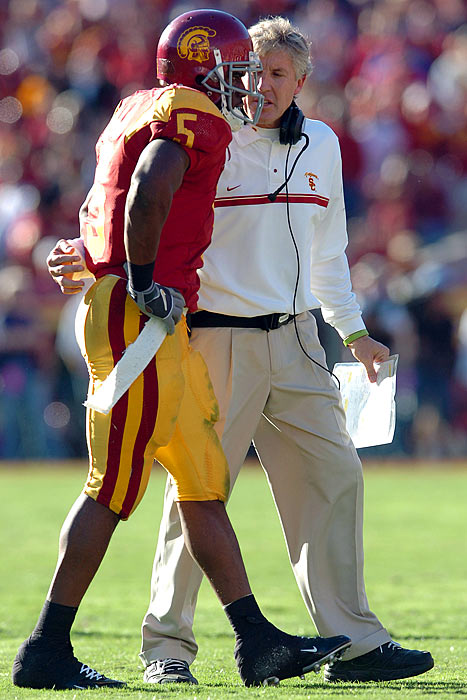 "After a four-year investigation, the NCAA hit USC with a two-year bowl ban, four years' probation, the loss of 30 football scholarships and the forfeiture of 14 wins from December 2004 through January 2006 for a ""lack of institutional control"" that let athletes receive improper benefits. Running back Reggie Bush, whose family got a rent-free home and other lavish gifts from sports marketers, forfeited his 2005 Heisman Trophy. The men's basketball team banned itself from postseason play in 2010 and vacated its wins from 2007-08. Football coach Pete Carroll and men's hoops coach Tim Floyd departed under a cloud for allegedly presiding over the rules violations. The women's basketball and tennis teams were also implicated."