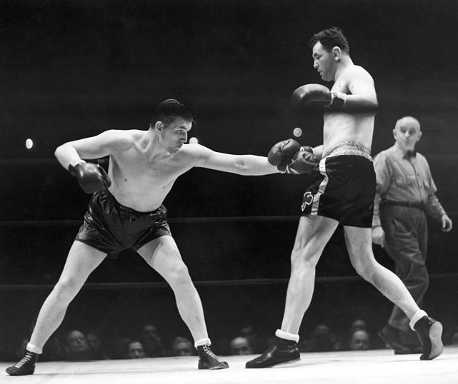 "He never won a world title, but Farr (left) pushed Joe Louis to the limit when they met at Yankee Stadium in 1937. Louis escaped with a narrow points decision over ""The Tonypandy Terror,"" with the crowd of 50,000 booing lustily when the referee seemingly raised Farr's glove by mistake as the verdict was announced."