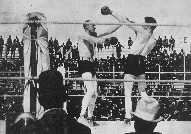 "The first three-division in boxing history, Fitzsimmons (left) captured belts at middleweight, light heavyweight and heavyweight. Though he stopped Peter Maher in an 1896 fight that was billed as a world heavyweight title fight, ""Ruby Robert"" didn't win the recognized lineal title until knocking out James J. Corbett in 14 rounds the following year."