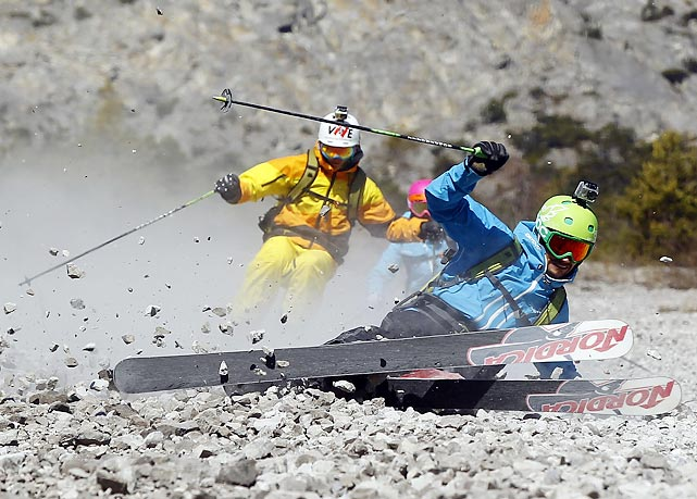 Freeride skiers carve up crushed rocks instead of snow on a slope in the western Austriana village of Haiming.