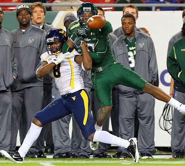 Mountaineers defensive back Keith Tandy covers South Florida receiver Sterling Griffin at Raymond James Stadium in Tampa. WVU, the Big East conference champions, won 30-27.