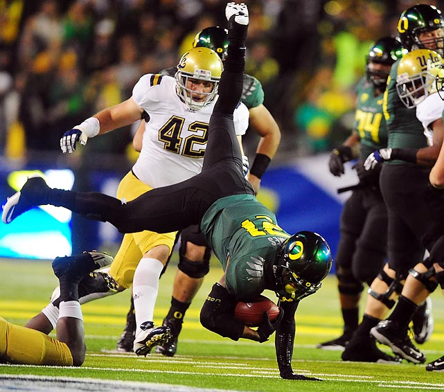 Oregon running back LaMichael James gets upended during the Pac-12 championship game against the UCLA Bruins. James and the Ducks won the expanded conference with a 49-31 victory.