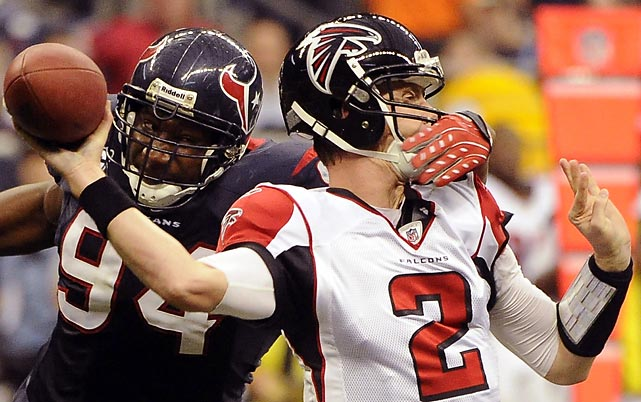 Texans defensive end Antonio Smith was flagged for roughing the passer after catching Falcons' quarterback Matt Ryan in the facemask during Houston's 17-10 win with third string quarterback T.J. Yates starting because of injuries.