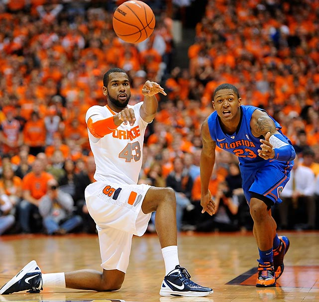 Syracuse forward James Southerland makes a pass from his knees against Florida. The Orange won 72-68.