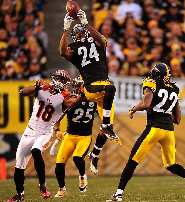 Steelers corner Ike Taylor intercepts an Andy Dalton pass intended for wideout A.J. Green. The Steelers dominated the divisional clash, winning 35-7 at home.