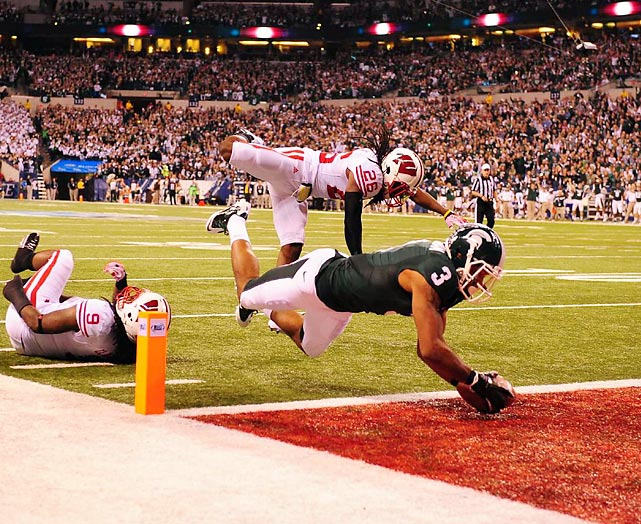 Michigan State wideout B.J. Cunningham dives into the endzone for one of his three touchdowns in the Big Ten championship game against Wisconsin. The Badgers topped the Spartans 42-39.