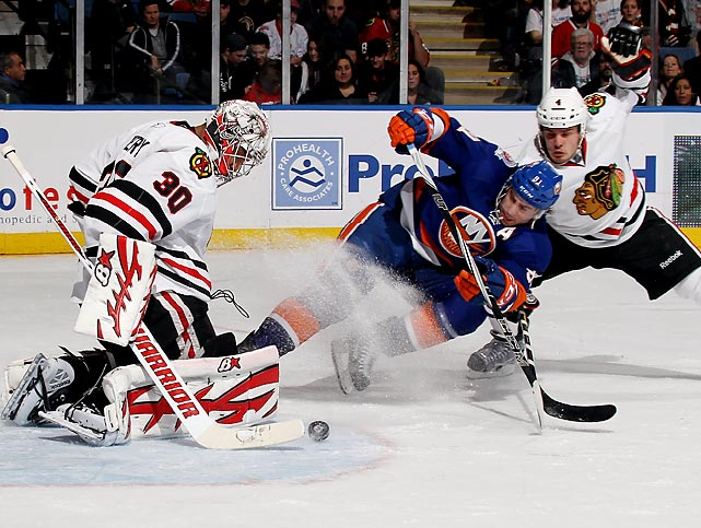 Blackhawks goaltender Ray Emery stops a shot from the Islanders' John Tavares during Chicago's 3-2 victory.