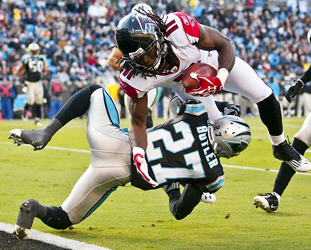Falcons wideout Julio Jones powers past Panthers cornerback Darius Butler to score during Atlanta's 31-23 win. Jones turned his three receptions into 104 yards and two scores.