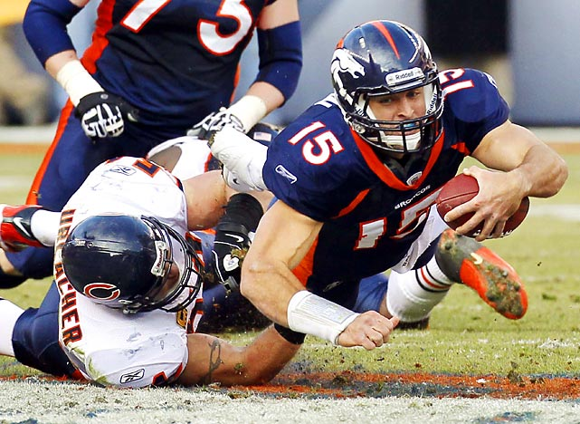 "Tim Tebow is tackled by Bears linebacker Brian Urlacher. After Chicago's 13-10 overtime loss to Denver, Urlacher called Tebow ""a good running back."""