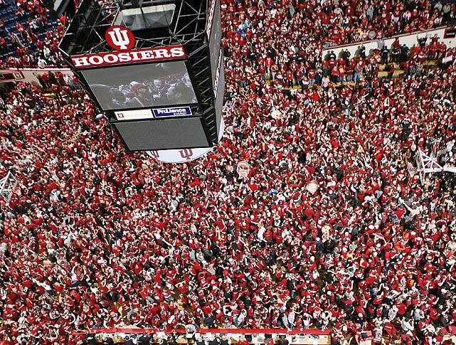 Hoosiers fans storm the court after unranked Indiana upset No. 1 Kentucky 73-72 on Saturday. Indiana is undefeated through nine games.