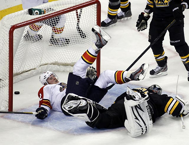 Florida Panthers right wing Tomas Kopecky falls over Bruins goalie Tim Thomas after scoring a third-period goal in Boston. The Panthers won 2-0.