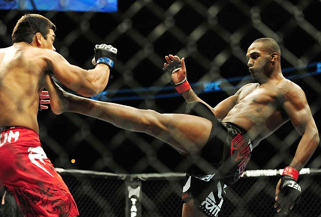 UFC light heavyweight Jon Jones kicks Lyoto Machida during the UFC 140 light heavyweight championship bout. Jones, the youngest champion in UFC history, retained his title with a technical submission victory.