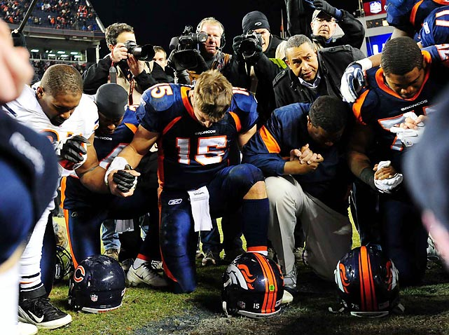 Tim Tebow leads his Denver Broncos teammates in prayer after a 13-10 overtime victory over the Bears.