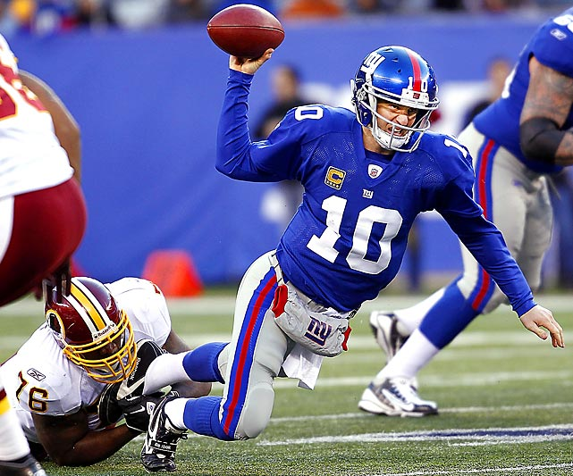 Redskins defensive end Darrion Scott sacks Giants quarterback Eli Manning during Washington's 23-10 victory.