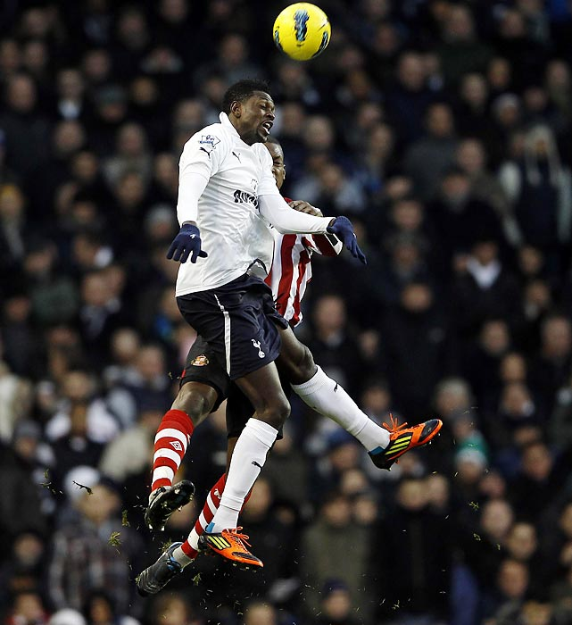 Tottenham's Emmanuel Adebayor (left) challenges Sunderland's Titus Bramble for a ball during an English Premier League soccer match.