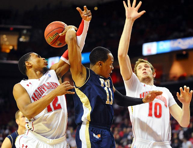 Florida International guard Phil Taylor (center) throws an over-the-shoulder pass against Maryland during the Terrapins' 65-61 win on Dec. 14.