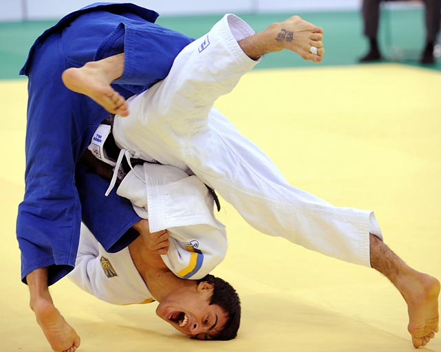 Ukraine's Georgii Zantaraia (white) flips Japan's Takato Naohisa during the International Judo Federation Grand Prix in China. Zantaraia won the title.
