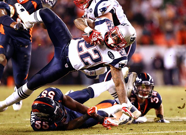 Patriots running back Stevan Ridley gets tackled low by Broncos linebacker D.J. Williams on Dec. 18. New England defeated Tim Tebow's squad 41-23.