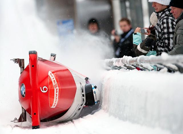 Pilot Gregor Baumann and the Swiss team cross the finish line on their side during the bobsled World Cup in Germany. The Swiss team was unharmed and finished in 11th place.
