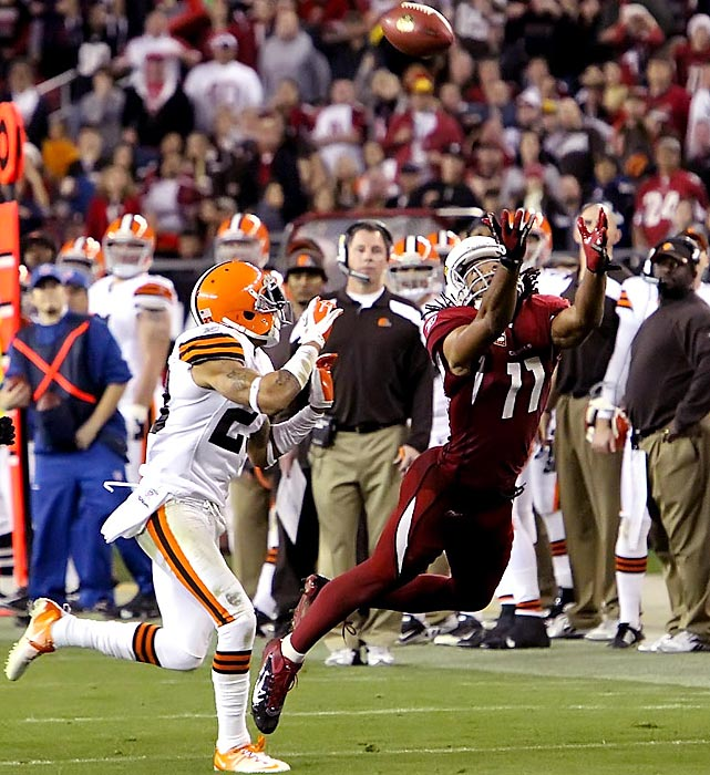 Cardinals wideout Larry Fitzgerald didn't come up with this catch, but he later came up with a 32-yard over-the-should grab in overtime to set up the winning field goal. The 20-17 win was Arizona's third overtime victory of the season.