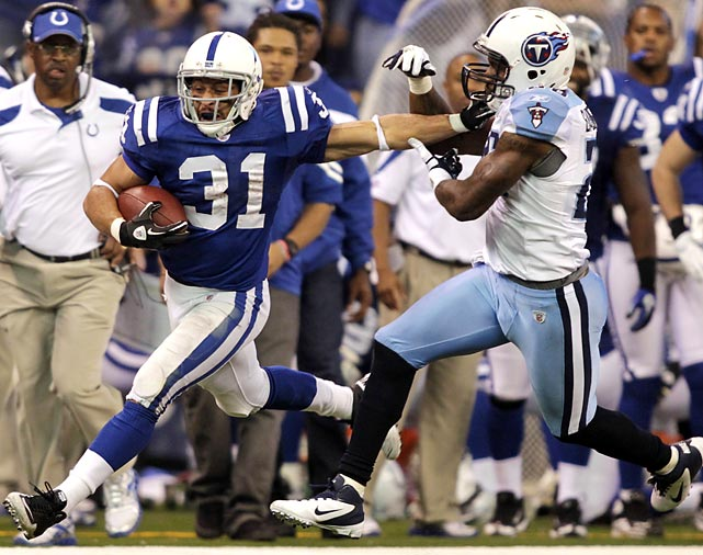 Colts running back Donald Brown stiff arms Tennessee Titans strong safety Jordan Babineaux during a 39-yard run in Indianapolis's 27-13 win, their first of the season. Brown ran for 161 yards and a touchdown in the contest.