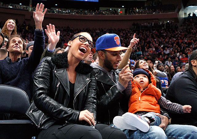 R&B singer Alicia Keys and producer husband Swizz Beatz watch the Knicks' opener courtside with son Egypt.