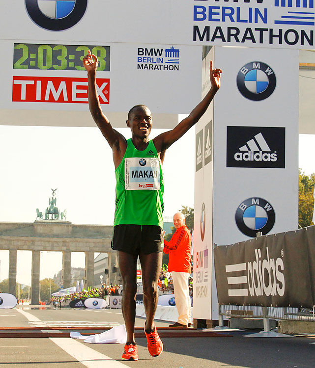 Defending champion Patrick Makau shattered the marathon world record, leading a Kenyan sweep in 2 hours, 3 minutes and 38 seconds and beating the old mark by 21 seconds. For 26.2 miles, Makau averaged 4:42 per mile. Makau's time has many thinking a sub-two-hour marathon is on the horizon.