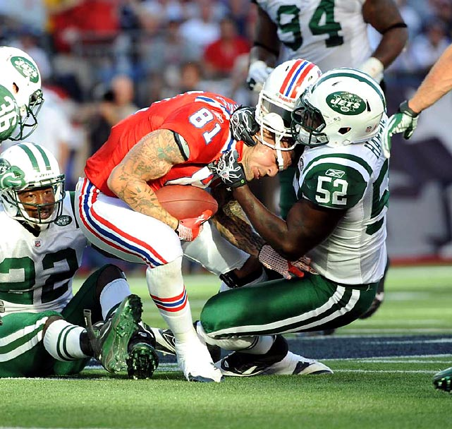 New York Jets linebacker David Harris rips the helmet off Patriots tight end Aaron Hernandez during their Week 5 contest. It wasn't enough. New England defeated New York 30-21.